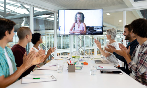 Business people attending video conference at conference room in a modern office